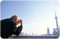 image of an old man looking toward Shanghai\'s �ֶ� Pudong skyline